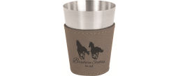 A fun, customizable shot glass.  It is stainless steel with a leather wrap.  It comes in a variety of colors.  Great for wedding party gifts, Valentine's, New Years or any special occasion.